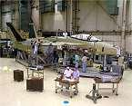 proceed Begin test aircraft modifications
