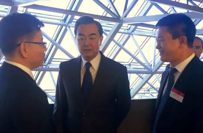 Xu Shaoshi (right), Director of National Development and Reform Commission and Zhang Xueshan  Kurexi Maihesuti (middle in the