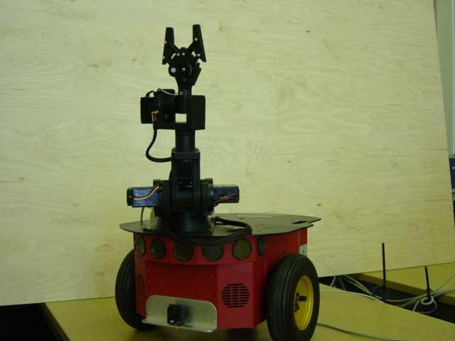 The robot is endowed with the basic components for sensing and navigation in a real-world environment. It is also equipped with a color tracking system.