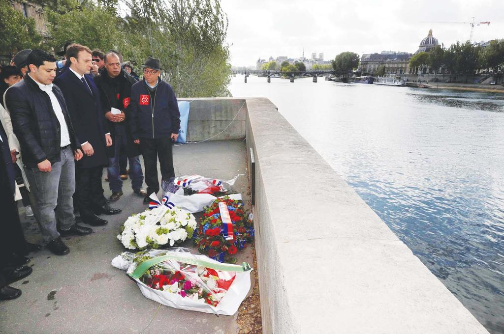 during a tribute ceremony on the banks of the Seine River in Paris, France on May 1.