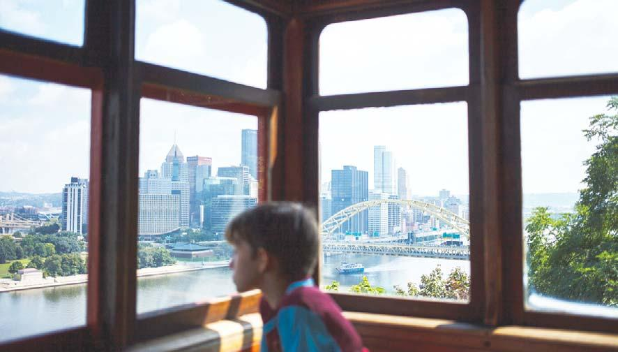 23 In this Aug 29, 2016 photo, downtown Pittsburgh is seen through the window of the Duquesne Incline in Pittsburgh, Penn. The incline opened in 1877 and was restored in 1963.