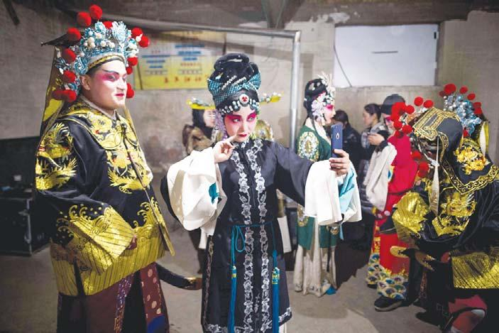 24 Arts An iron rice bowl no more Opera troupe tours rural China defending dying art YUXIAN, China, May 1, (AFP): For the 50-year-old Chinese opera performer, every aspect of the dimly-lit backstage