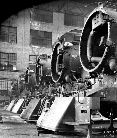 Right: Southern Pacific 4-8-4 Daylight steam locomotives under construction inside the Lima Locomotive Works