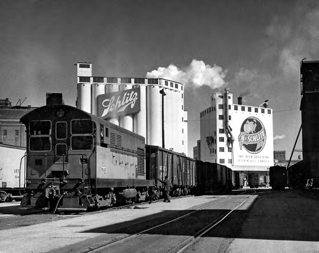 Milwaukee Road Fairbanks-Morse locomotive switching boxcars at the Schlitz brewery on the Beer Line in