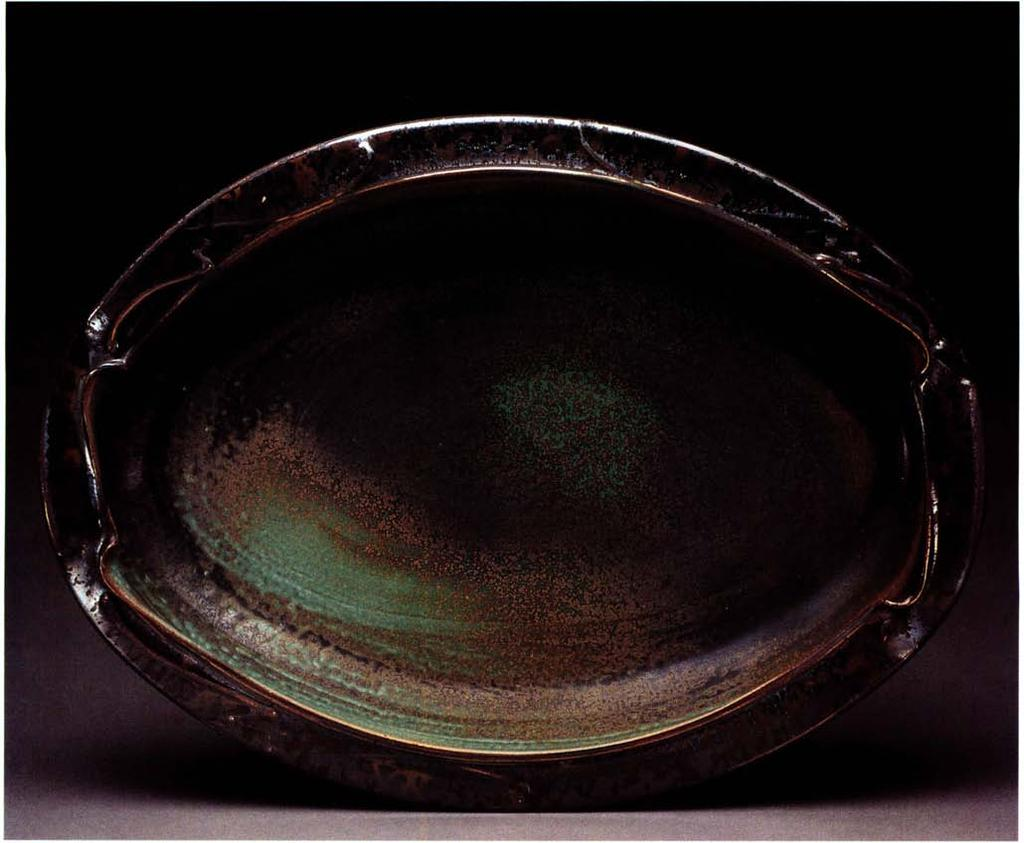 Oval tray, 19 inches in length, thrown, altered and assembled stoneware, single fired.