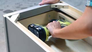 Place the front panel against the drawer box, while resting on top of the
