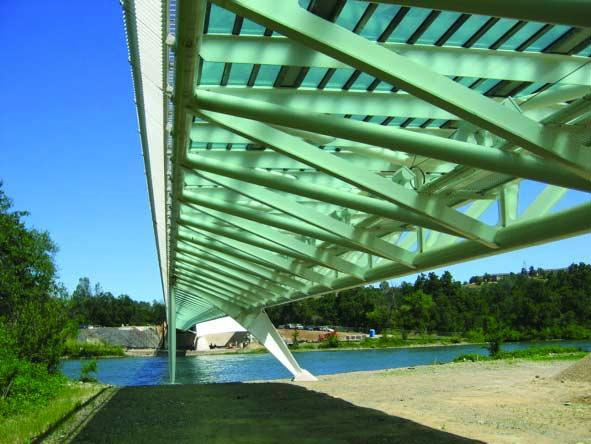 The bridge deck consists of translucent glass panels with granite accents.