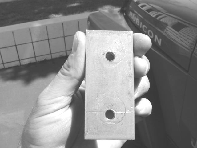 to tighten the lower door hinge without the door moving. (Figure 1). 3. When you remove the lower door hinge a backing plate (figure 2) will come loose.