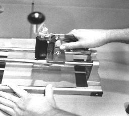 Squeeze the Press Handle (#A) downward, lifting the drill point and knife body above the level of the cutter base.