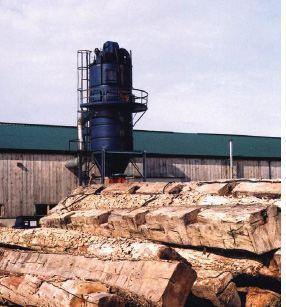 The only wood that comes through the mill gate at Century Wood Products is old wood (left) primarily from barns, but also from older industrial-type buildings.