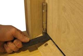of the door and the Bottom Swivel. Lift Door Into Position and Screw In Top Swivel 3. Fitting the Handle Hinge Set 3.