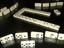 Dominoes From Wikipedia, the free encyclopedia Dominoes (or dominos) generally refers to the collective gaming pieces making up a domino set (sometimes called a deck or pack) or to the subcategory of