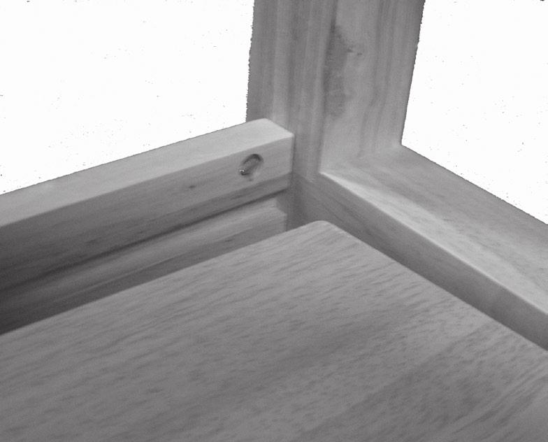 3. Once both Legs have been fastened to the Cross Brace, slide the Shelf (2) above against the Legs so that the far edge fits onto the groove on the Cross Brace. See Figure C, right.