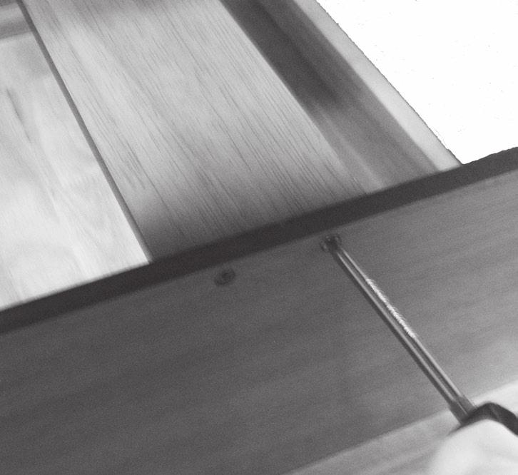 Screws. 11. Set the Lower Support (15) across the top of the Sliding Partition and against the sides of the Legs.