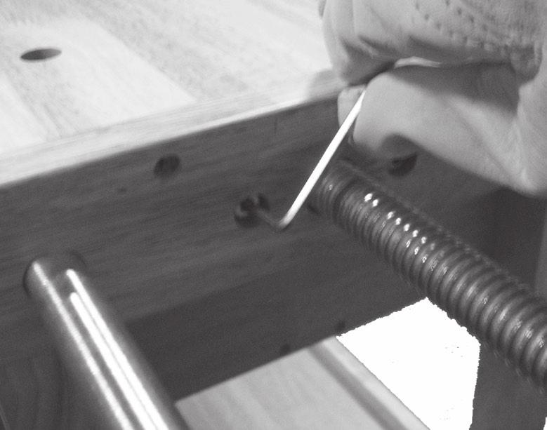 Once the Vise is threaded into the holes halfway, use the Hex Wrench to tighten the screws on either side of the Vise s center thread. See Figure N, right. 16.