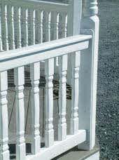 Keep legs of railing centered on the post. Railings will keep posts plumb once all seven railings are installed.