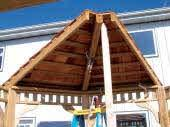 On larger gazebos, or if helper has trouble holding up the center part of the roof section, fasten a 2x4 to prop up the
