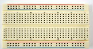 5. BREADBOARD A breadboard is a material or a device used to build a prototype of an electronic circuit. The breadboard has many strips of metal (copper usually) which run underneath the board.