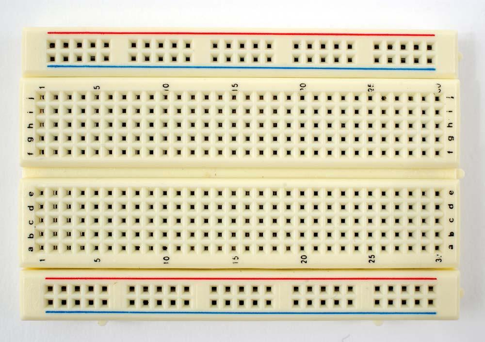 Bread Boards: In the lab and whenever we are first trying out a circuit we use what are known as breadboards which have many small holes in their surface big enough for the leads of components to go