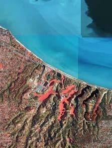 Four basic operations or corrections must be applied to the standard vertical aerial photograph to produce an orthophoto: standardization of scale across the image (i.e., use a DEM to normalized the distance from the camera to the ground ) removing the relief displacement to position the terrain in its true location.