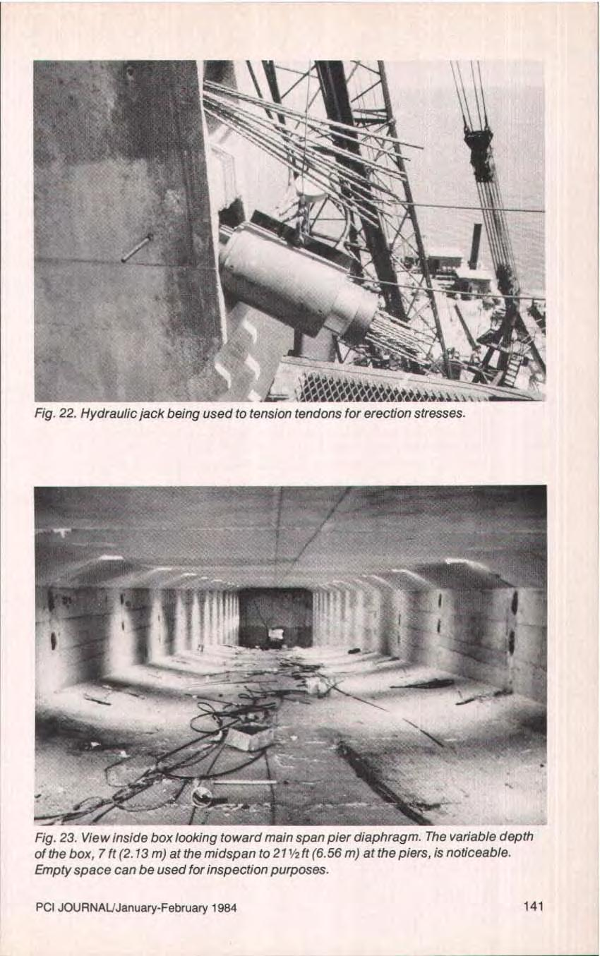 Fig. 22. Hydraulic jack being used to tension tendons for erection stresses. Fig. 23. View inside box looking toward main span pier diaphragm.