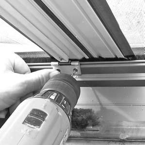 "Using the slide bolt keeper as a guide, drill two 3/32"" diameter pilot holes into the sill track through the keeper"