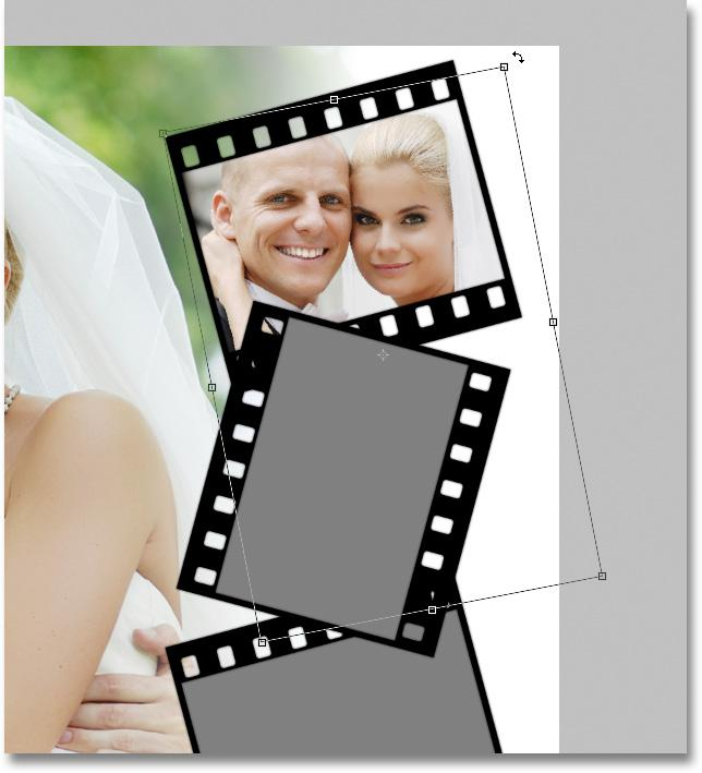 This tells Photoshop to clip the photo to the shape on the photo area layer below it, and now, only the area of the photo that falls within the boundaries of the shape remains visible in the document.