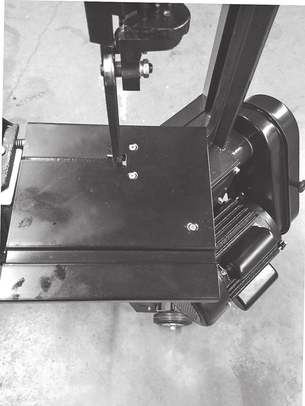 Install Vertical Cutting Table and fasten with previously removed screws (FIG. 9). 5. Install the table support bracket with pre-installed hex bolt and a M6X12 flat head screw, washer, and nut. 6.
