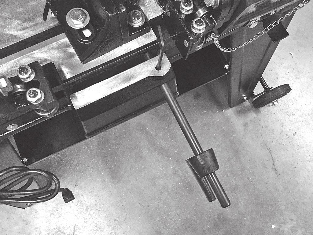 Slide work stop into place and tighten set screw (FIG. 5). 6. Before operating Bandsaw, it is recommended to square the vise and table bed to the blade.