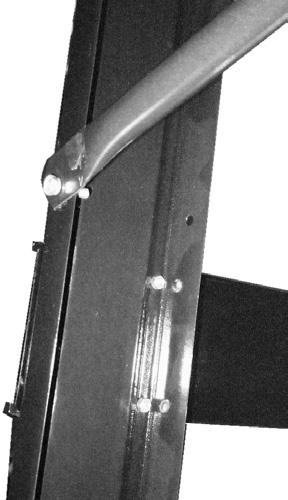 Nut (15) Leg (3) Carriage Bolt (14) Brace (4) Figure C a. Press the flat side of the Brace against the outside of the Legs. b.