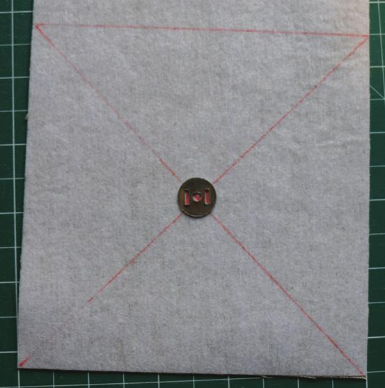 7. On the utensils pocket mark a dot 1 from the bottom and 1½ in from the side of the bottom left hand corner (the bottom is the unhemmed edge) on the right side of the fabric.