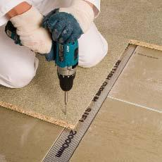 Lay flooring, following good joinery practice, across the channels and screwfix through the Gyproc Plank to the