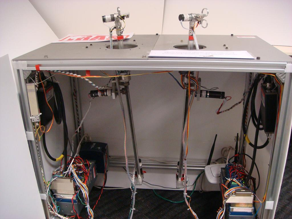LabVIEW and CompactRIO (a) Computer and GUI (b) Fig. 1 Structure of surgical training system. (a) Robotic device for laparoscopic surgical training.