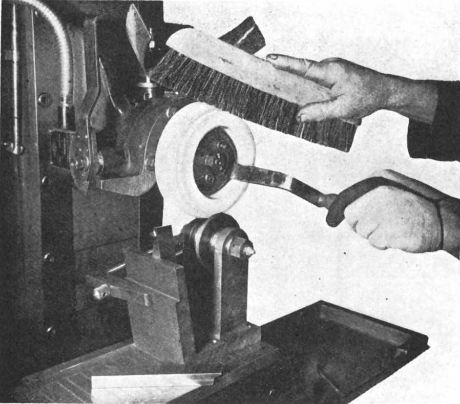 GRINDING-WHEEL FORM-CRUSHING 213 Figure 17.1 View of surface grinder, showing grinding wheel being turned by hand against the roller.
