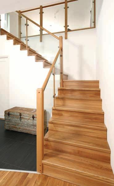 Straight Staircase Stepped treads Design in black stained oak, white risers and hidden strings.