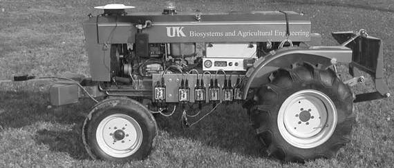Figure 5. Test vehicle for autonomous guidance. vehicle for this project was an 8.6 kw hydrostatic drive tractor (fig. 5).