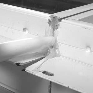 Caulk Joints & Apply Sill Gasket FIGURE 1 1.