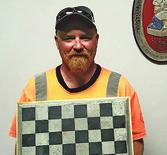 Brother Bill Gillespie shows off his polished and stained concrete chess board. Looks great!