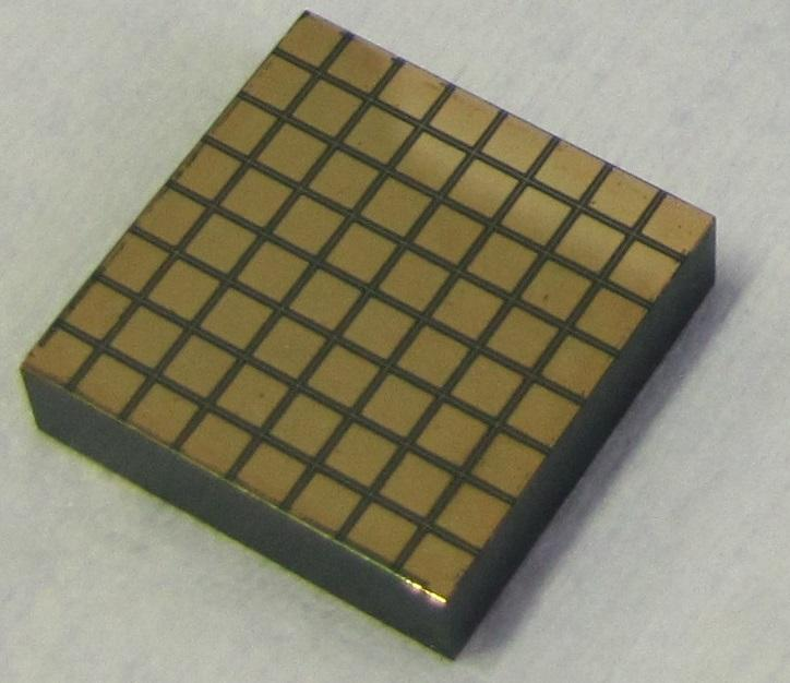 Figure 1. A 5mm thick pixelated CZT detector from Redlen Technologies [18] with 8 8 electrodes (each 2.2mm 2.2mm) on the front side (left) and a continuous planar electrode (19.42mm 19.