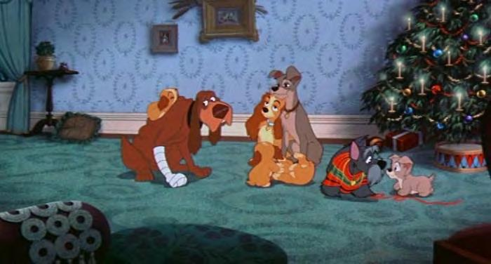 Figure 10. Lady and Tramp can be seen here side by side in a heterosexual union caring for their puppies.