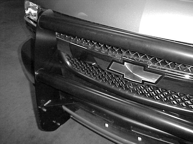 3. Install the lower Grille Guard Tube. Photo 0. Use the plastic washers at the ends of the Tubes. Use Plastic Washers at ends of grille guard Tubes.