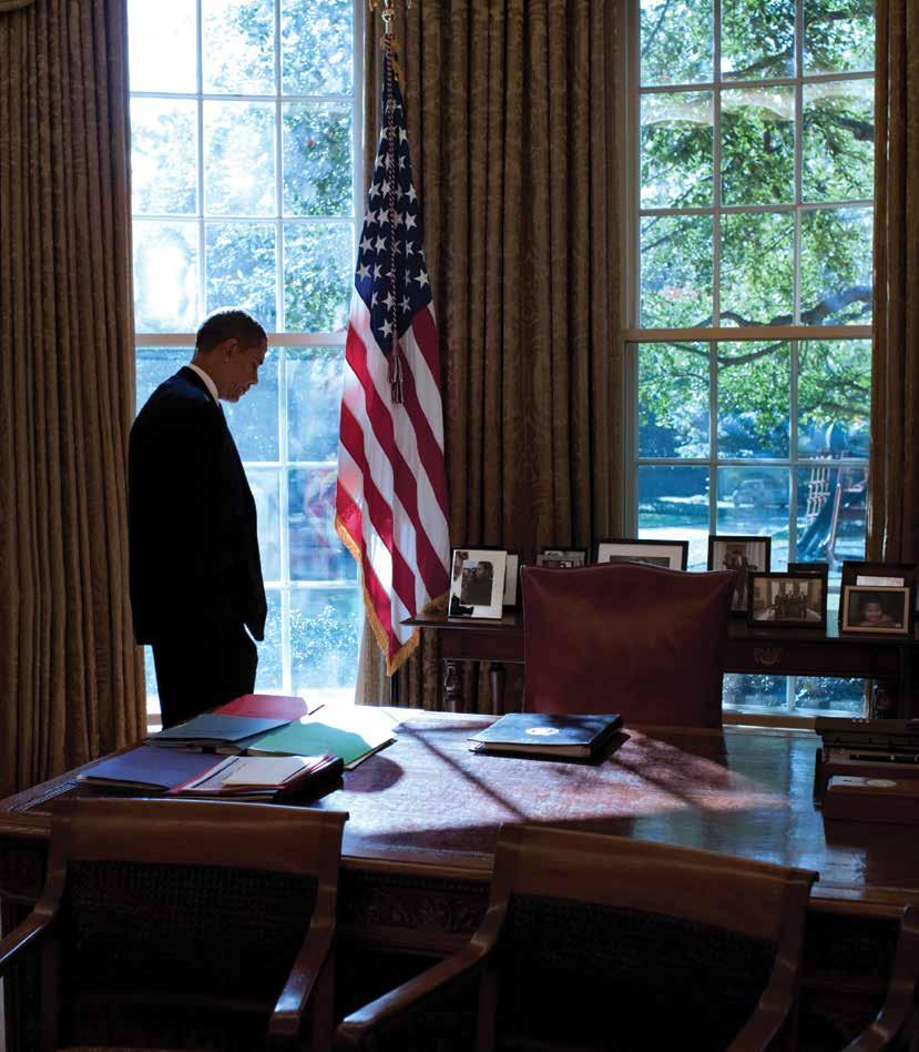 President Barack Obama 83 walks to his desk in between