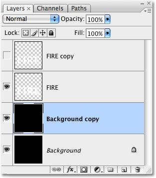 Click OK when you re done to exit out of the dialog box and Photoshop applies the blurring effect. Your streaks should now have a softer look to them: The white streaks now appear with a soft blur.