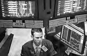 BUSINESS 42 A trader works on the floor of the New York Stock Exchange in late afternoon trading on Aug 3 in New York City.