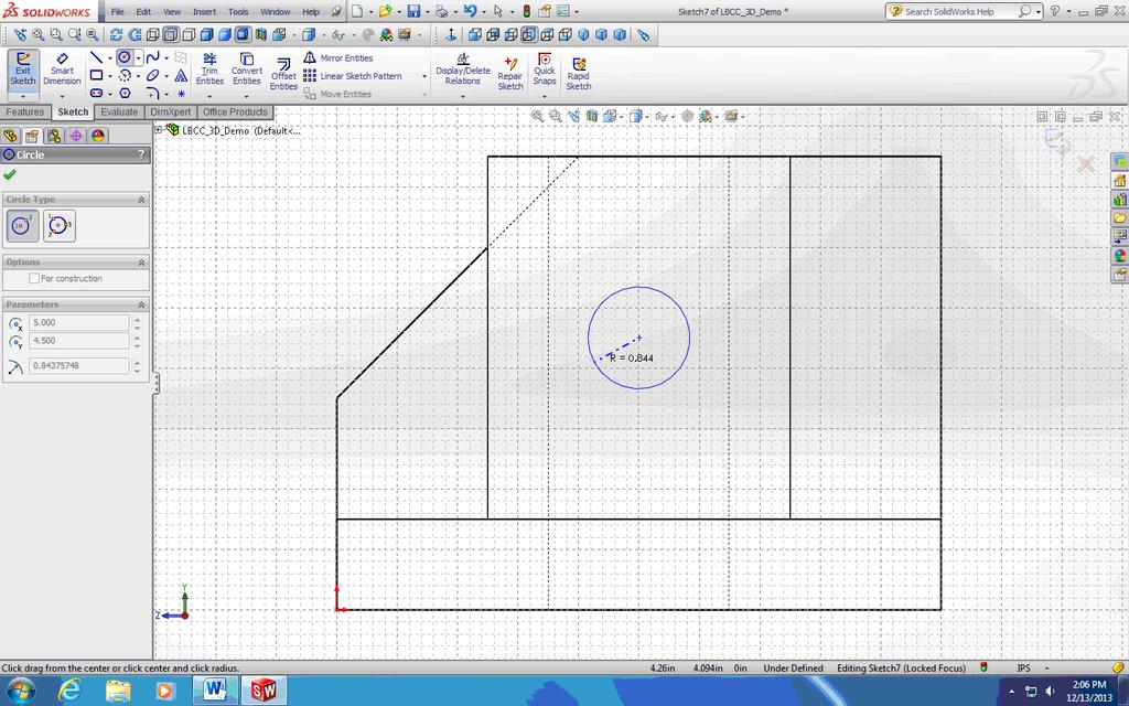 Circle tool, move the mouse over the center point of the top edge of the cylindrical boss to pick up the snap, then move the mouse downward vertically; then move the mouse over the left vertical edge
