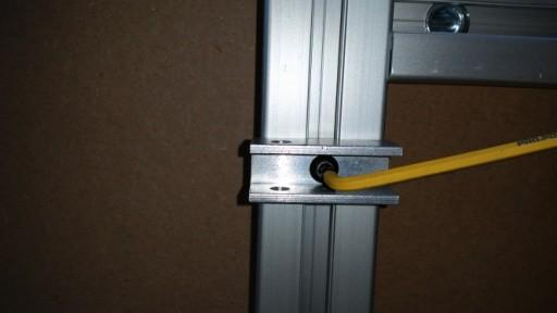 c) Line up each top rail pivot bracket to each Vertical Wall Support as