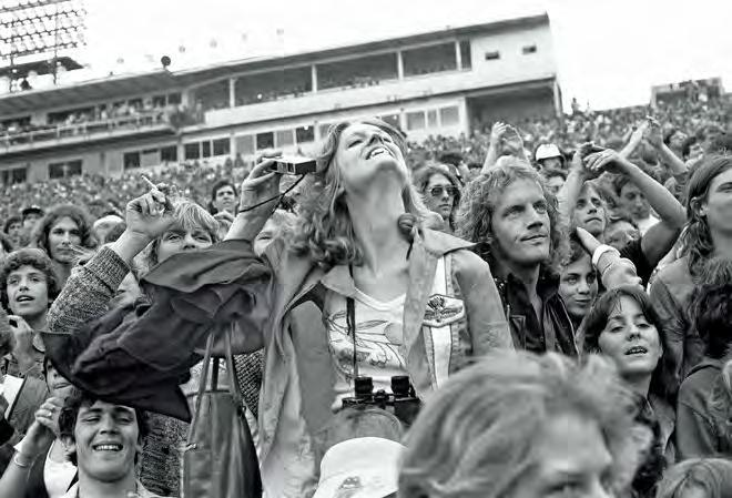 Szabo came to JFK Stadium armed with a couple of Canon cameras, a Rolleiflex, and a bag full of film, but he never aimed his lens at the main stage; his interests were far afield.
