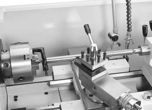 Seat the center firmly into the quill during workpiece installation by rotating the quill handwheel clockwise to apply pressure, with the center engaged in the center hole in the workpiece.