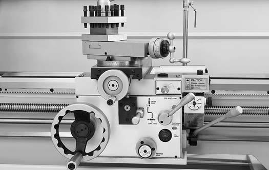 "For Machines Mfg. Since 5/11 OPERATION 14"" TURN-X Toolroom Lathe Manual Feed The handwheels shown in Figure 65 allow the operator to manually move the cutting tool."