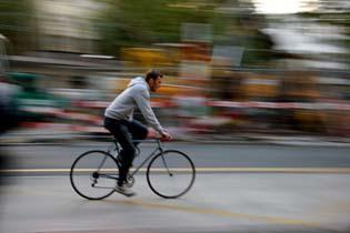 Stop Action with Blurred Backgrounds This is achieved by following your subject with the camera. This is called panning.